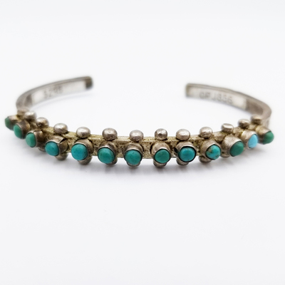 Title: Bracelet: Zuni Single Turquoise Row , Size: 3/8 inch wide , Medium: Sterling Silver , Edition: Vintage
