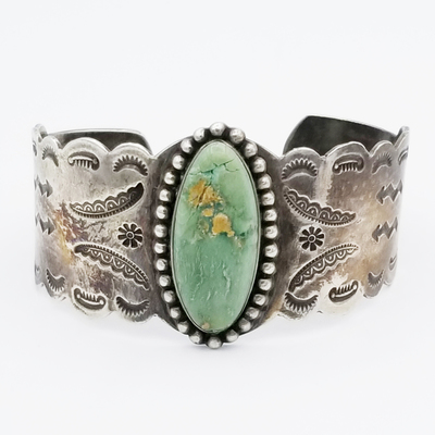 Title: Bracelet: Gorgeous Navajo Turquoise Oval Stone with Interesting Stamping , Date: c.1930's , Size: 1 3/8 inches wide , Medium: Sterling Silver