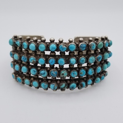 Title: Bracelet: Zuni Four Row Round Turquoise , Size: 1 1/4 inches wide , Medium: Sterling Silver , Edition: Vintage