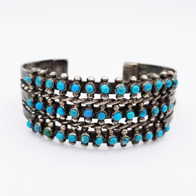Title: Bracelet: Early Zuni Snake Eye Turquoise with Braided Silver , Date: c. 1900 , Size: 1 inch wide , Medium: Sterling Silver , Edition: Vintage